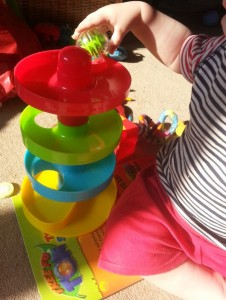 plastic helter skelter toy with large balls