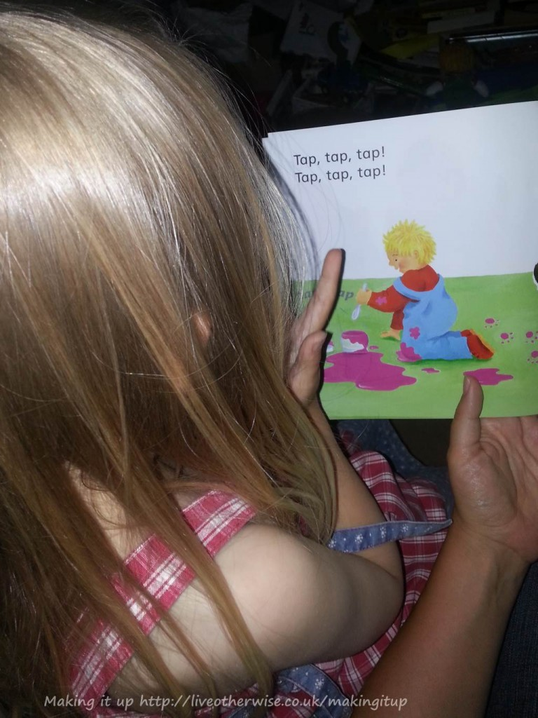 Smallest reading her first book