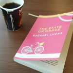 proof copy of the state of grace by rachael lucas next to a cup of coffee